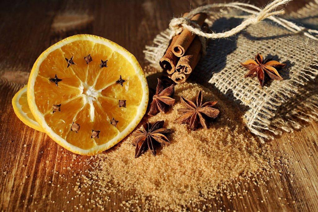 Cinnamon,, Orange Star Anise and Cloves on table
