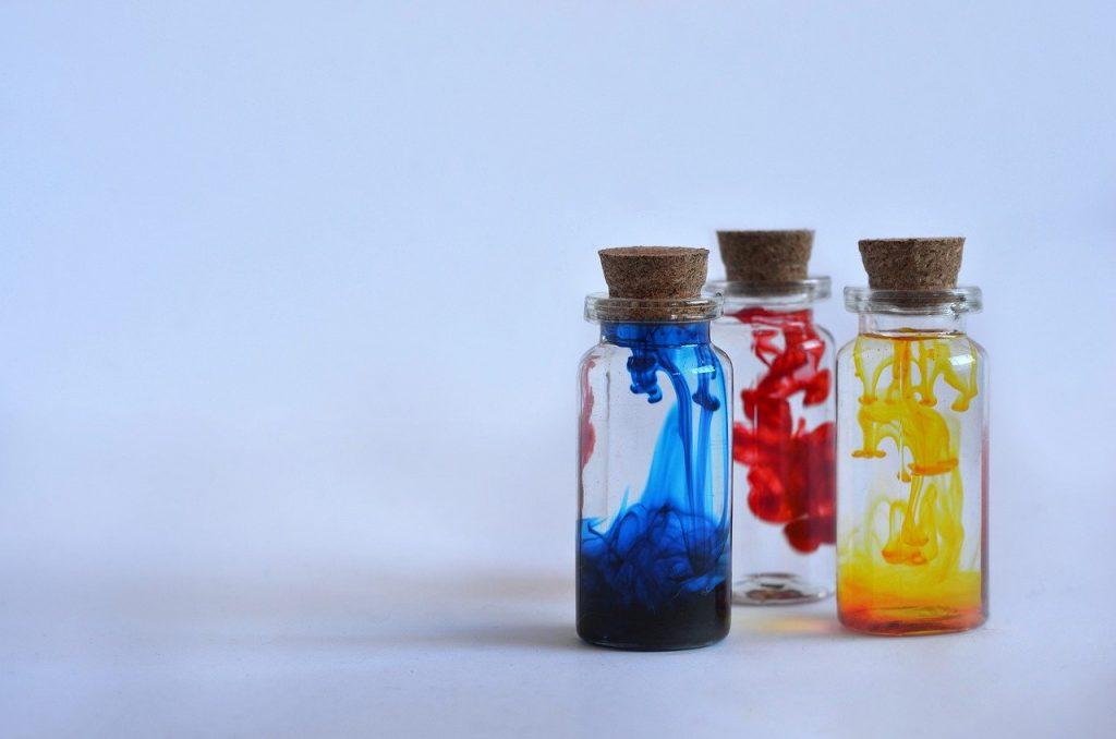 three bottles with liquid inside