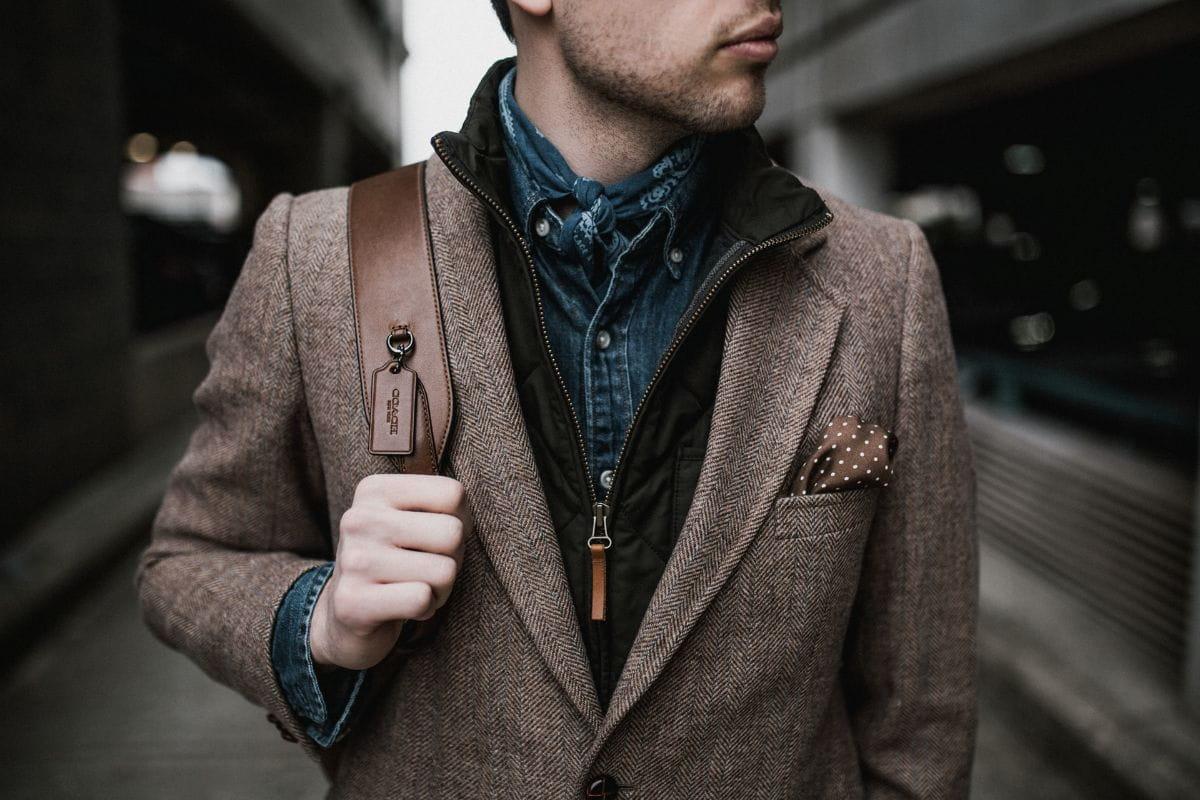 man in brown suit jacket - most worn perfumes