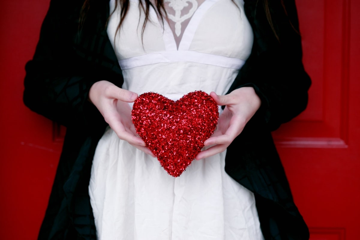 woman holding a heart - Valentine's Day Perfume Gifts For Her
